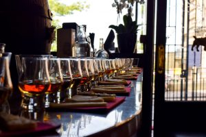 row of whisky glasses